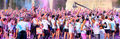 People at the Holi Color Run Party in the streets of the city Royalty Free Stock Photo