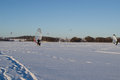 People ice sail surf kiteboard snow lake winter lot of sailing surfing and kiteboarding on frozen galves in trakai amazing cold Stock Images