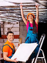 People installing suspended ceiling in builder uniform Royalty Free Stock Photography