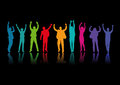 People jumping for joy colorful silhouetted group of on a black background Royalty Free Stock Images