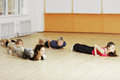 People laying down on the floor gym Royalty Free Stock Photography