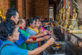 People lighting incense Wat Yai Chaimongkol Ayutthaya bangkok th Stock Photo