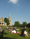 People in a local park londoners enjoy the sunny british weather london Stock Photos