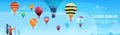 People Looking At Colorful Air Balloons Flying In Sky Banner