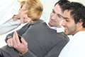 People looking at mobile telephone Royalty Free Stock Photo