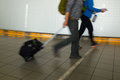 People with luggage walking at the airport details blurred motion Stock Image