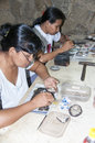 People making jeweleries by hand Royalty Free Stock Photo