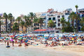 People at mediterranean beach in sitges spain august august spain resort known for its sandy Royalty Free Stock Photo