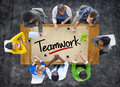 People in a Meeting and Single Word Teamwork Royalty Free Stock Photo