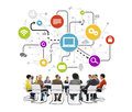People in a meeting with social networking concepts group of multi ethnic and related symbols above Stock Photo