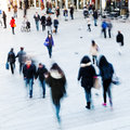 People in motion blur on the move in the city crowd of walking a square Royalty Free Stock Image
