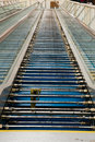 People mover escalator repair stripped down with pieces taken off it for repairs at an airport Stock Photo