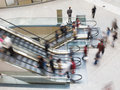 People moving on an escalator in a mall up and down Royalty Free Stock Photography