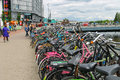 People near the bicycle parking near a canal in Amsterdam Royalty Free Stock Photo