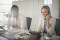 People in operations center talking on Landline phone. Royalty Free Stock Photo