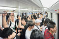 People packed in a train car, Shanghai, China Royalty Free Stock Photo