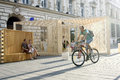 People passing on lipscani street man riding a bicyle besides poiana lui iocan architectural pavillion during the architectural Royalty Free Stock Photography