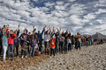 People in a peaceful demonstration on a beach to protect it from construction Royalty Free Stock Photo