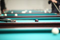 People play in pool in billiard club Royalty Free Stock Photo
