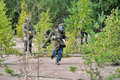 People playing paintball tournament in the woods st petersburg russia Stock Image