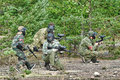 People playing paintball tournament in the woods st petersburg russia Stock Photo