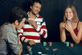 People playing poker at home Stock Photos