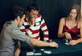 People playing poker at home Stock Photography