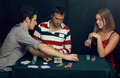 People playing poker at home Stock Images