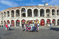 People pose at the arena of verona italy aug visitors di on aug in italy was built by romans in st century ad in Royalty Free Stock Photography