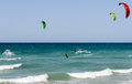 People practicing kitesurf on the beach of torre canne italy june puglia italy Royalty Free Stock Image
