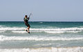 People practicing kitesurf on the beach of torre canne italy june puglia italy Stock Photo