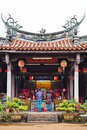 People pray for god in traditional oriental heritage temple in Taiwan