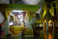 People praying with buddha statue inside cave at wat tham khao y yoi on december in phetchaburi thailand Stock Images