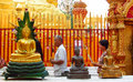 People praying toGolden Buddha statue in Buddhist temple Royalty Free Stock Photo