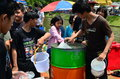 People prepare cold water for celebrating songkran thai new year water festival chiang mai thailand april with gun in the streets Stock Photos