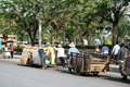 People pull carts on the road in Thailand. Royalty Free Stock Images