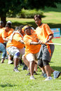 People pull rope in team tug of war competition atlanta ga usa september a pulls hard the at a day for kids an event where adults Stock Photography