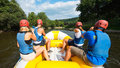People rafting a group of friends in an inflatable raft moving down a river Royalty Free Stock Photos