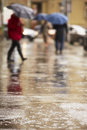 People in rain city street heavy selective focus Royalty Free Stock Image