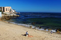People relax on the beach at pacific grove in monterey california usa Stock Photo