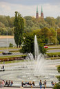 People resting by a fountain. Warsaw. Poland Stock Photography