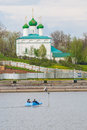 People ride on a blue katamari on zilive cheboksary chuvash republic russia against the background of naho church o archangel Royalty Free Stock Photo