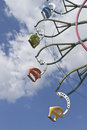 People Riding High On the Ferris Wheel.jpg Royalty Free Stock Photo