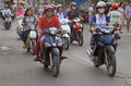People are riding on motorcycles in Hanoi, Vietnam Royalty Free Stock Photo