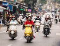 People riding motorcycles on the road at Hanoi, Vietnam