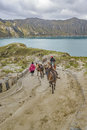 People Riding Mules at Road in Quilotoa Lake, Ecuador