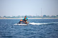 People riding on watercraft summer fun active Stock Photos