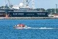 People in rubber boat with motor float baltiysk russia june by shipyard science ship kaliningrad region Royalty Free Stock Photos