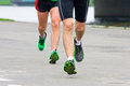 People running in city marathon foots and legs Royalty Free Stock Images