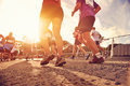 People running marathon race competing in fitness and healthy active lifestyle feet on road Royalty Free Stock Photography